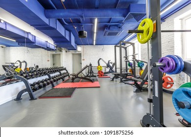 fitness club interior, equipment for workout, gym.