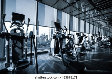 Fitness club in luxury hotel interior in the morning with sunshine.