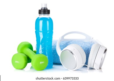 Fitness concept. Dumbbells, headphones, water bottle and towel. Isolated on white background