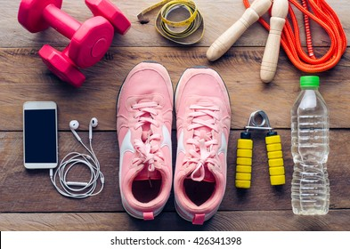 fitness concept with Exercise Equipment on wooden background