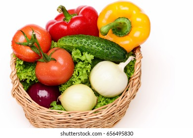 fitness concept, vegetables or green lettuce leaf, tomatoes with onions, peppers, cucumber in basket isolated on white background