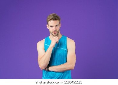 Fitness consultant think analyze training. Thoughtful sportsman analyze sport motivation. Sportsman thoughtful face analyze workout result violet background. Man coach think about personal training.