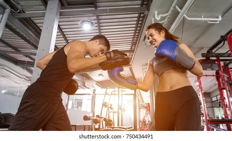 Fitness couple asian doing exercises the boxing. Concept of healthy lifestyle in the gym.