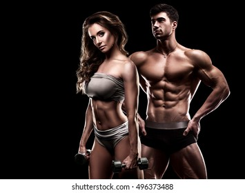 Fitness couple on a black background