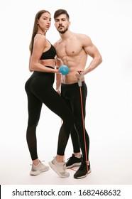 Fitness couple posing in studio