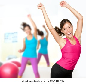 Fitness dance class aerobics. Women dancing happy energetic in gym fitness class.