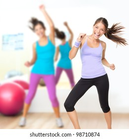Fitness dance studio class. Dancing woman in gym during exercise dancer workout training with happy fresh energy.
