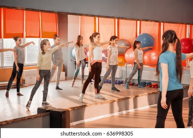 Fitness, dancing, sport, training, gym, children healthy lifestyle concept - Group of sportive of teenage girls exercising in the gym