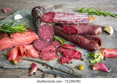 Fitness dry horse salami sausages and carpaccio with rosemary and garlic
