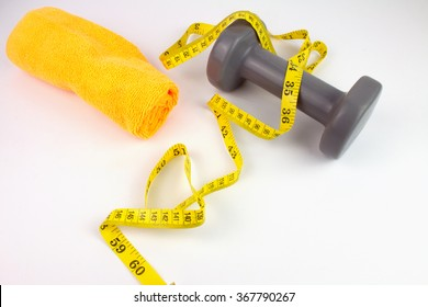 Fitness Dumbbell and Measuring Tape Isolated.