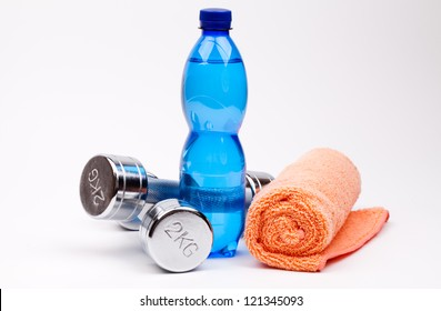 fitness dumbbells and bottle of water
