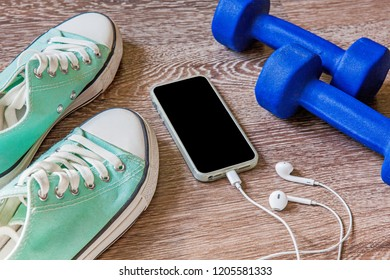 Fitness equipment and accessories on wood floor, Workout concept