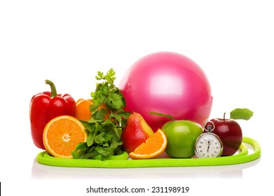 fitness equipment and healthy food isolated on white (green and red apples, pepper, salad,orange, pear, measuring tape, jump rope, ball, stopwatch )