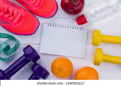 Fitness equipment, healthy food and notebook. Healthy and active lifestyle. Diet plan concept.