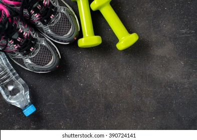 Fitness equipment on dark background