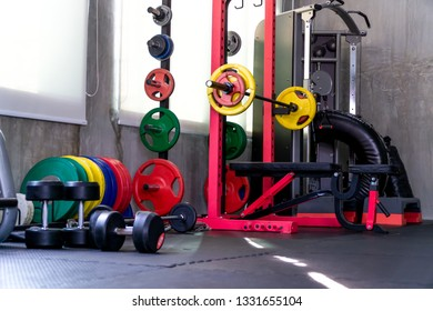 Fitness equipment such as barbell, weight plates, various colors for various bench press and dumbbell positions