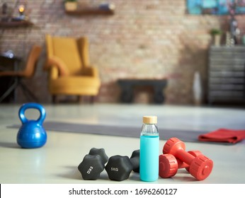 Fitness equipments at home. Focus on fitness tools, barbell and kettlebell. Concepts about home workout, fitness, sport and health.