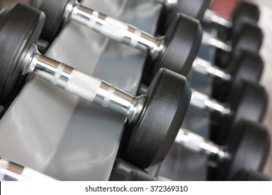 Fitness exercise equipment dumbbell weights.