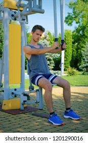 Fitness, exercising boy at the gym, outdoors