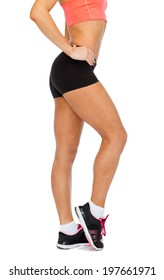 fitness, exercising and dieting concept - close up of female legs in sportswear