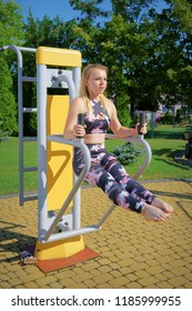 Fitness, exercising girl at the gym, outdoors