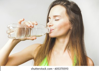 Fitness female drinks water
