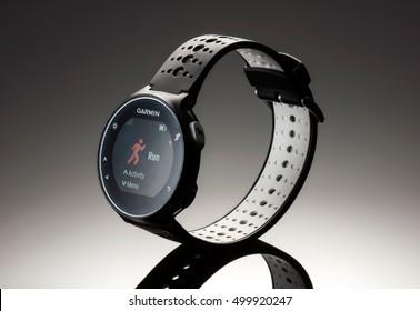 Fitness garmin 230 watch 2016 on dark background studio shot