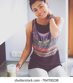 Fitness girl cooking healthy food in the kitchen