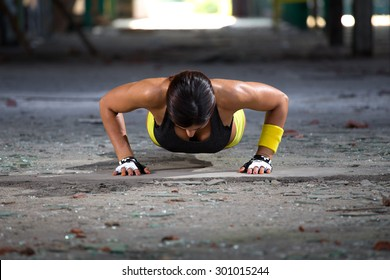 fitness girl doing pushups