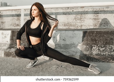 Fitness girl in doing yoga fitness exercise in the city.sport concept.