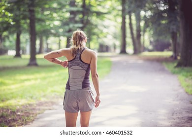 Fitness girl exercising and stretching outdoor