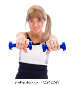 Fitness girl holding weights in hand, focus on them
