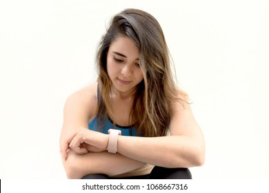 Fitness girl looking at her watch