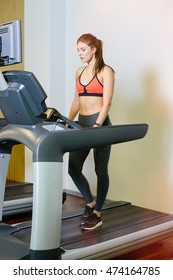 fitness girl on the treadmill . The concept of health, sports
