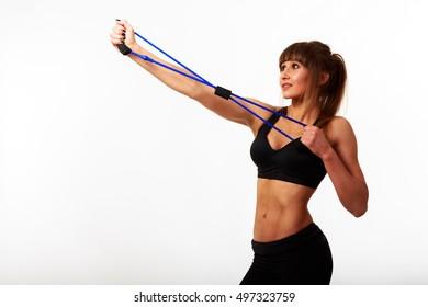 Fitness girl posing on black