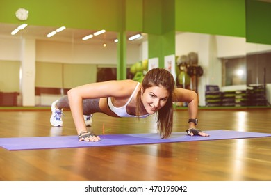 fitness, girl pushed in the gym. The concept of Health, sports