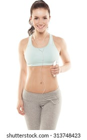 fitness girl with a smartphone on a white background, enjoys sports training, gym workout