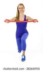 Fitness girl is stretching the rubber to stretch