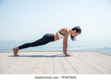 Fitness Girl working out on the beach