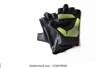 Fitness gloves use for training at gym or fitness center isolated in white background, workout routine protecting hands when lifting weight, has copy space, sport equipment, healthy lifestyle concept.
