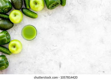 Fitness greeny drink with vegetables on stone background top view mock-up