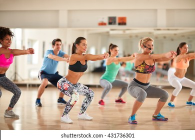 Fitness group doing exercises for shaping breech on fitness class