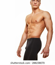 Fitness guy shirtless posing on white background