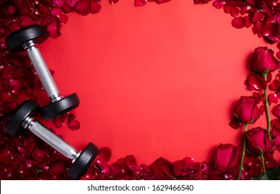Fitness Gym equipment background valentine's day concept with dumbbells on red rose empty floor isolated