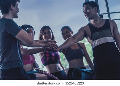 Fitness Gym friend team having fun with in the gym, for healthy lifestyle and team work and togetherness concept.