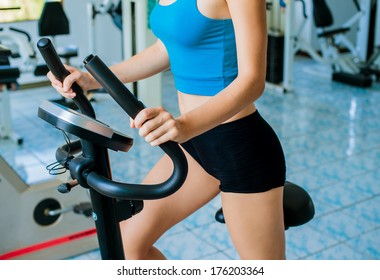 Fitness in the gym. Sport and shaping. Detail.
