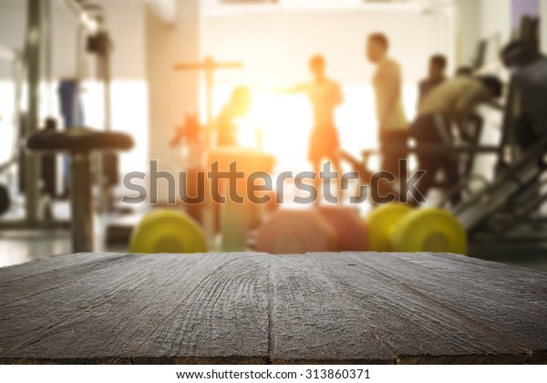 fitness gym and wooden table space