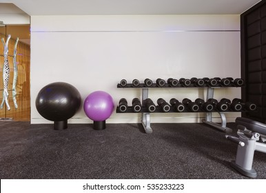 Fitness hall with sport equipment interior