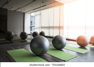 Fitness hall with sport equipment interior of gym with yoga