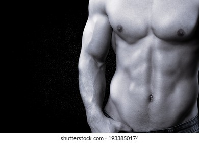 Fitness handsome male model posing in studio